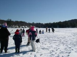 kids ice fishing on the lake