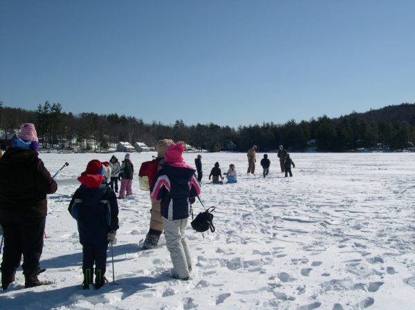 kids ice fishing on the lake