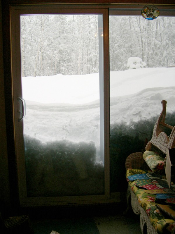 high snow piled up looking outside