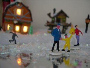 people skating in the miniature Christmas village