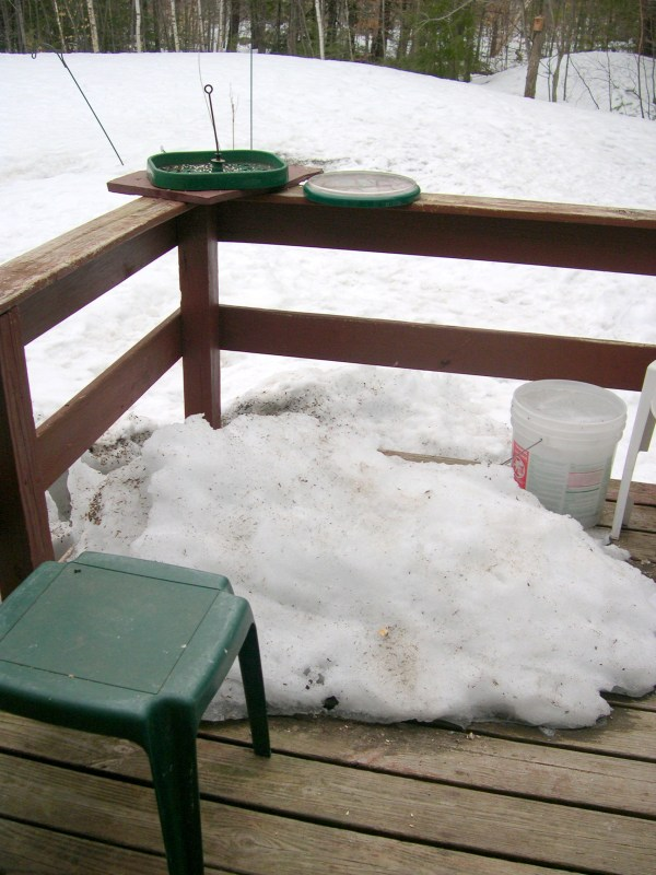 Frozen pile of snow on the deck