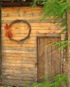 wooden shed with wreath