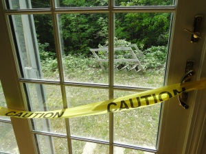 glass slider with caution tape