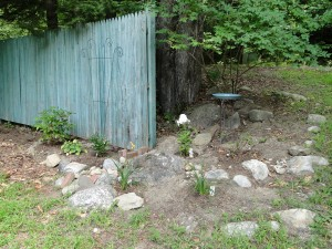 fence and rock garden