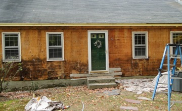 rotted wood on house