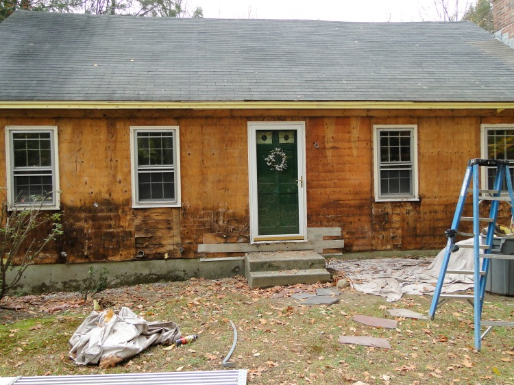 My house with the old clapboard siding removed to show rotted wood.
