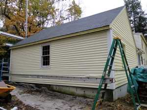 new yellow siding on garage