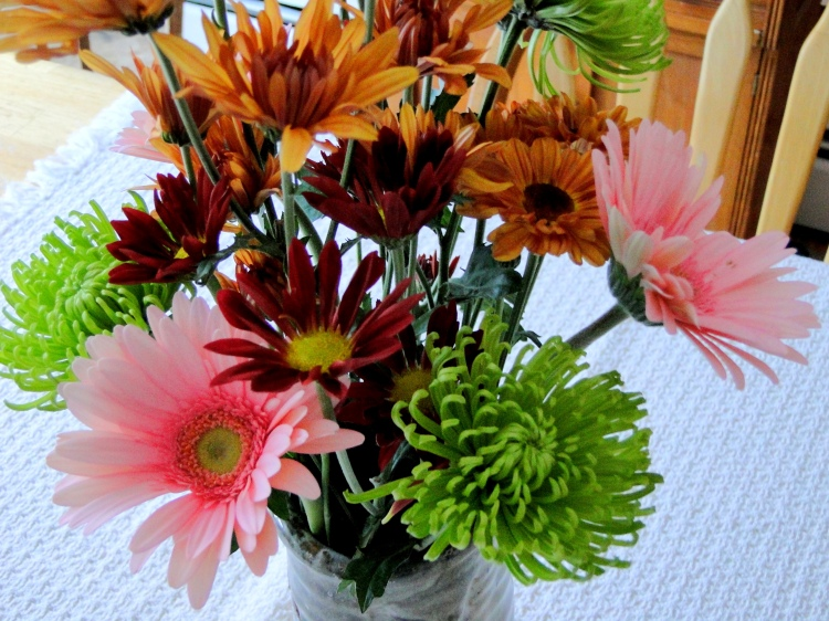 Pink, green and bronze flowers in a vase