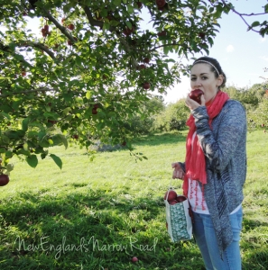 girl eating apple in orchard