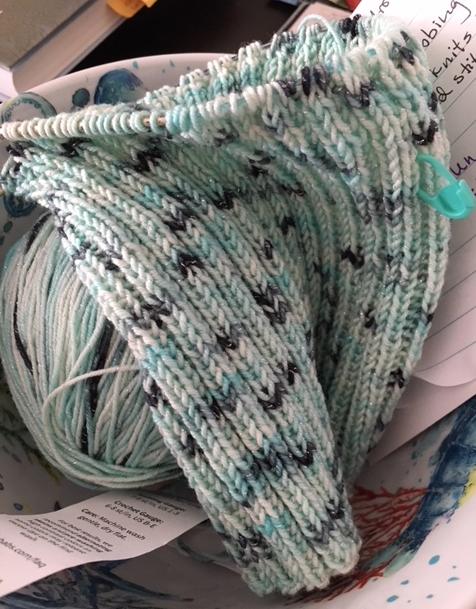knitting a blue hat