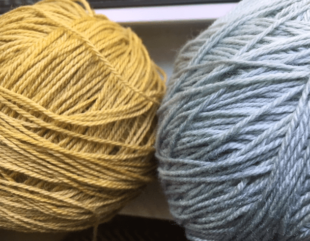 yellow and blue balls of yarn