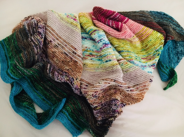 My colorful version of the free pattern: scrappy bias shawl