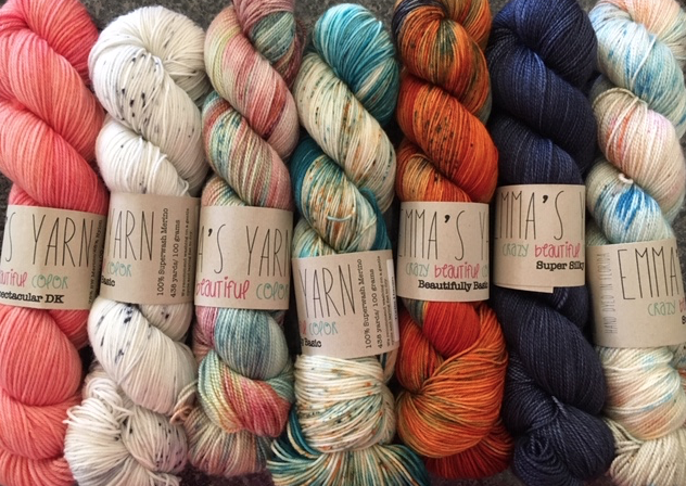 Colorful skeins of Emm'a Yarn hand-dyed in semi-solid, speckled and variegated colors.