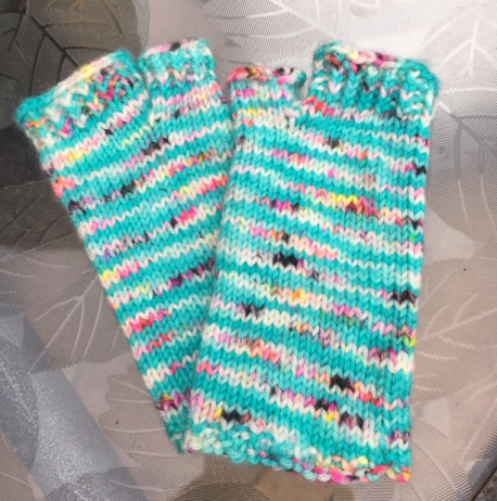 Flip flop socks in aqua blue variegated yarn with open toes and no heel.