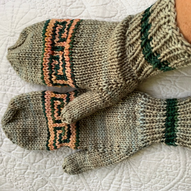 Pair of hand-knit mittens with Greek key pattern