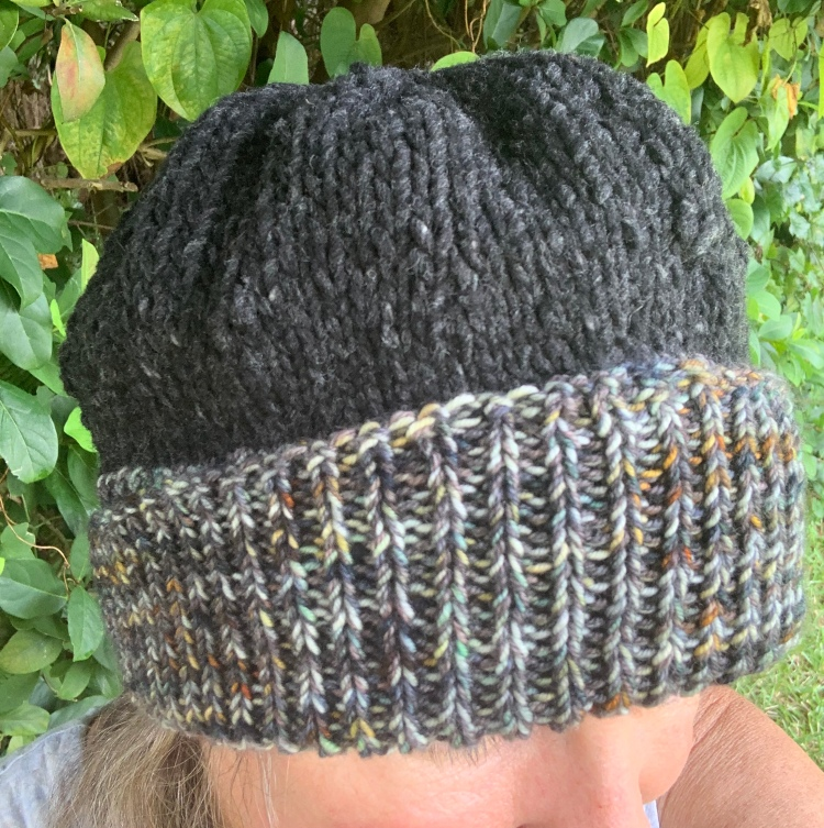 Hand-knit winter hat with roll brim