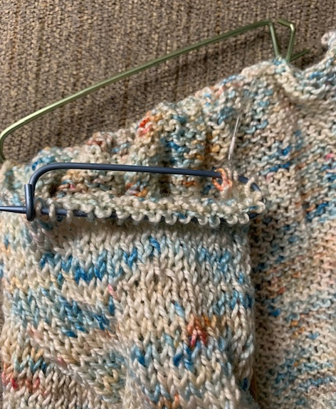 Knitting stitches on hold