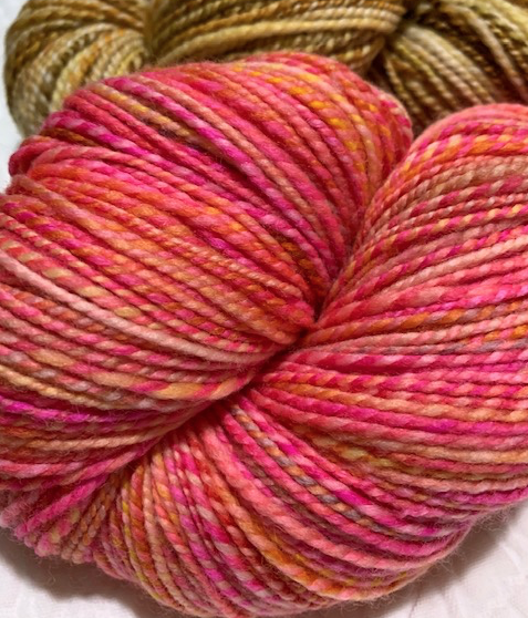 Bright pink handspun yarn
