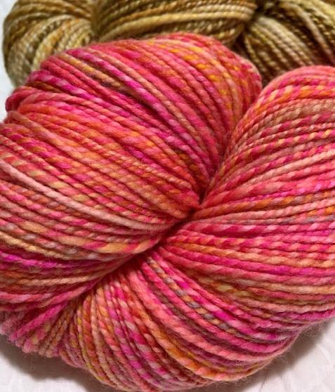 Bright pink handspun yarn