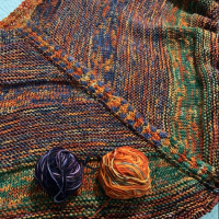 Knitting The Moon Sisters Shawl Pattern in Orange