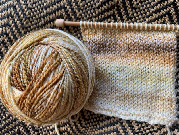 Handspun swatch in tan variegated