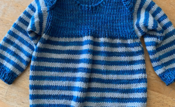 Completed knitting the Polliwog Popover baby sweater