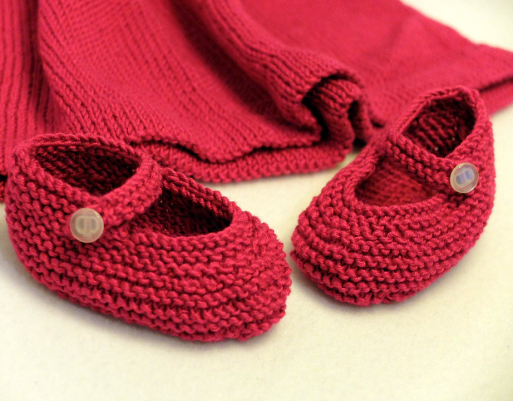 Red baby booties hand knit