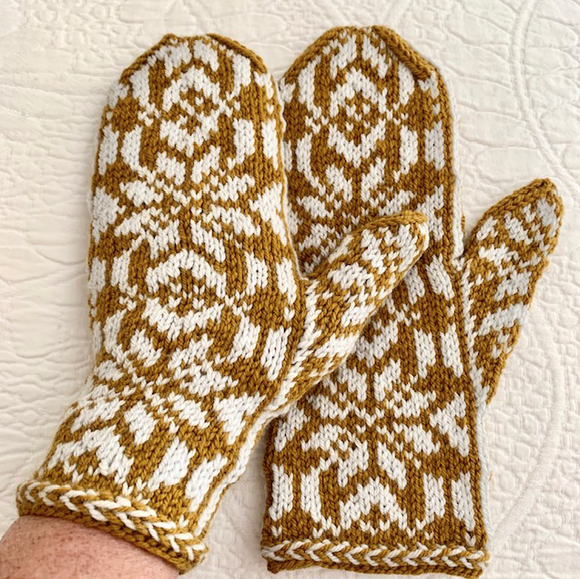 hand-knit mittens in gold and off-white