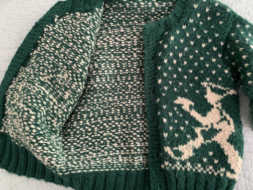 Inside floats of stranded knitting on child's sweater