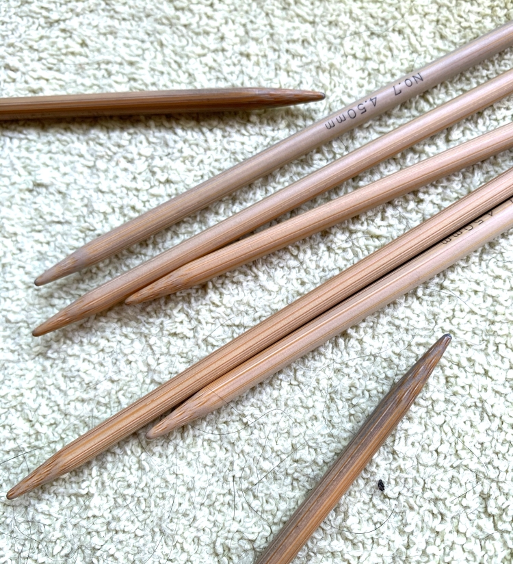Bamboo needles turning blue from yarn dye