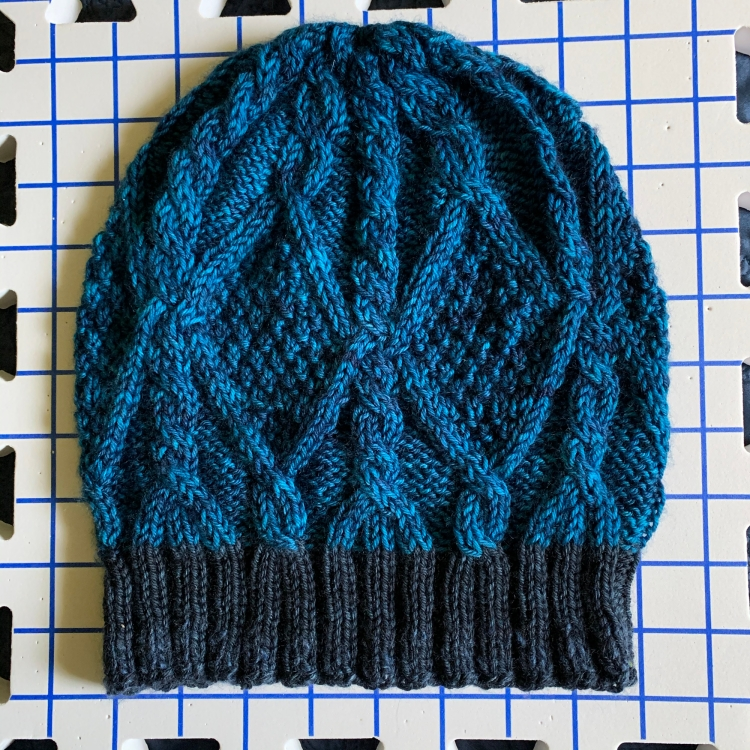 Skiff hat pattern with cables