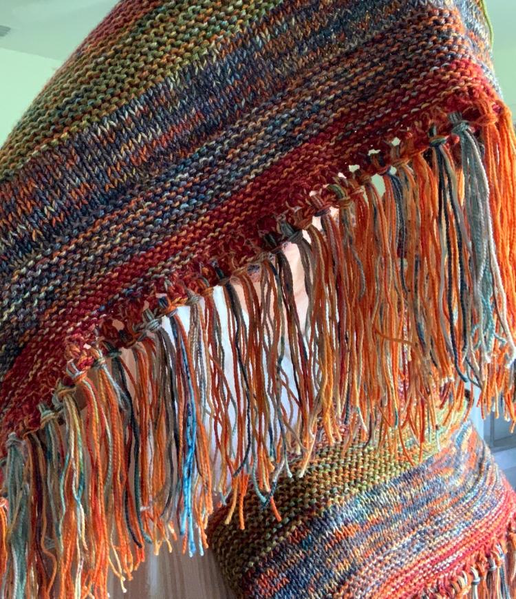 Fringe on orange Moon Sisters shawl
