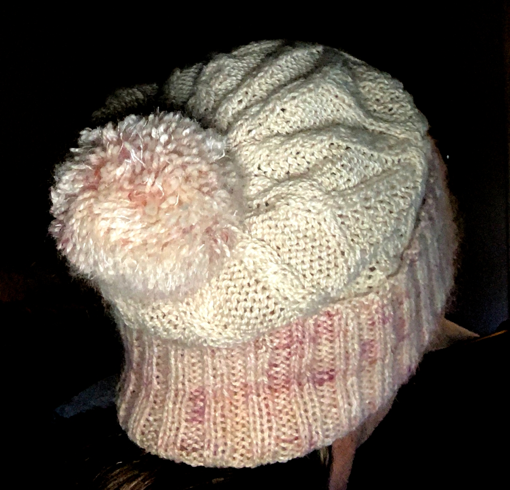 White and pink Skiff Watch cap on my head