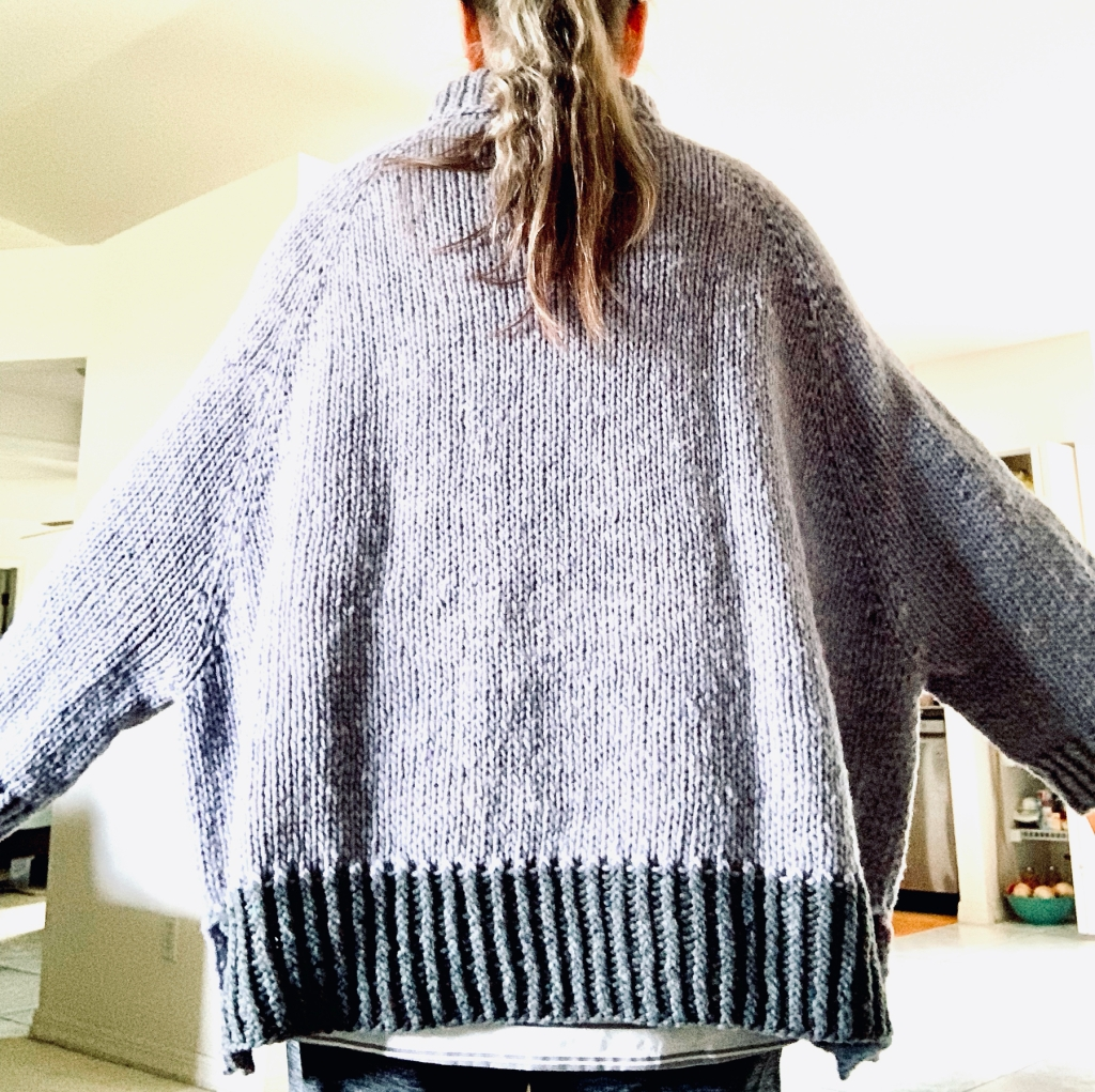 Turtle Dove hand-knit sweater in Quarry yarn, back view