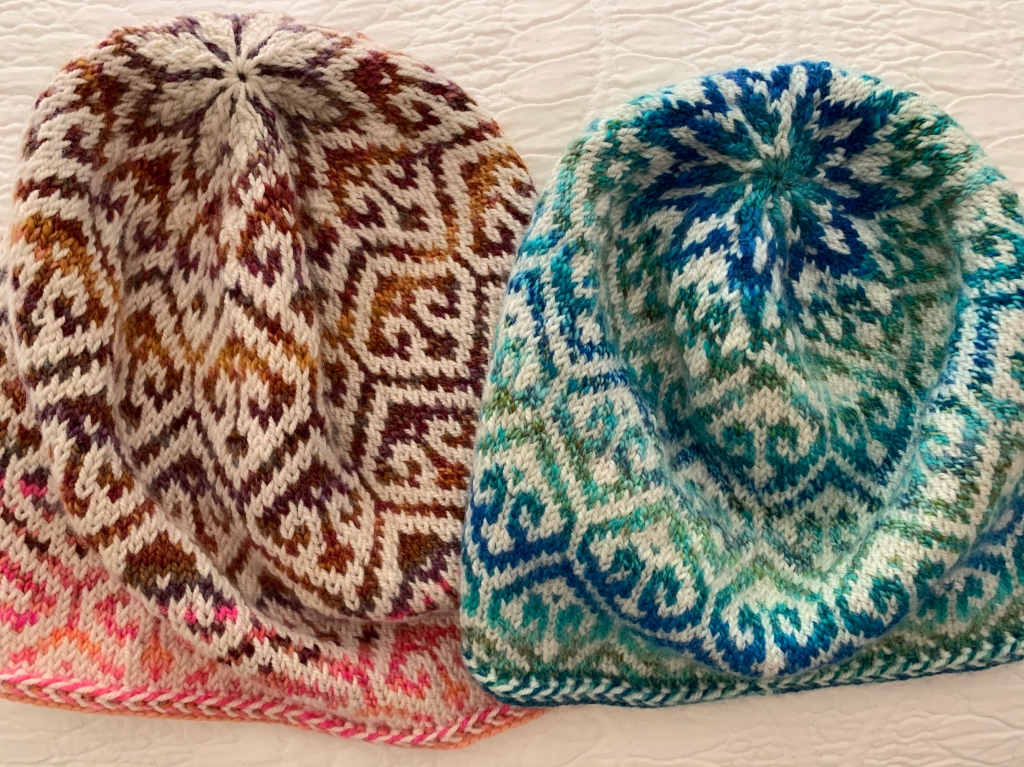Blue and brown versions of the hand-knit caps