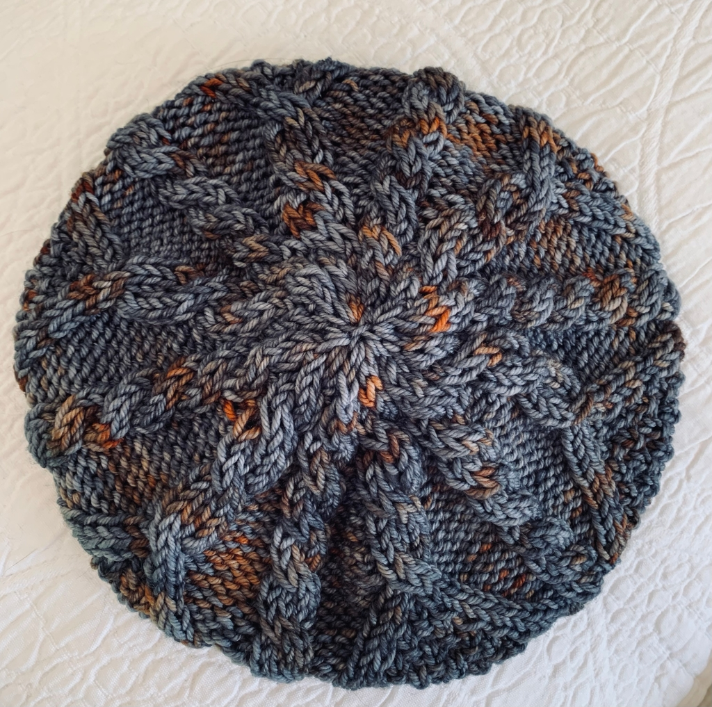 Top of Skiff beanie with cables