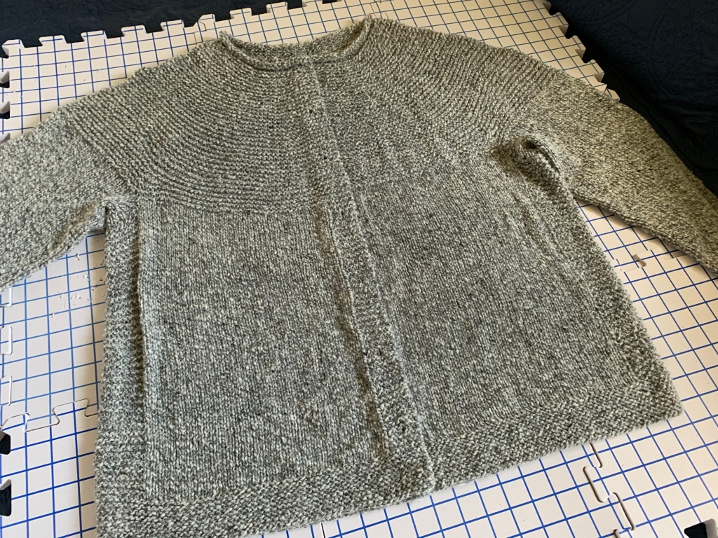 Cobblestone Cardigan knitting project on the mats and drying