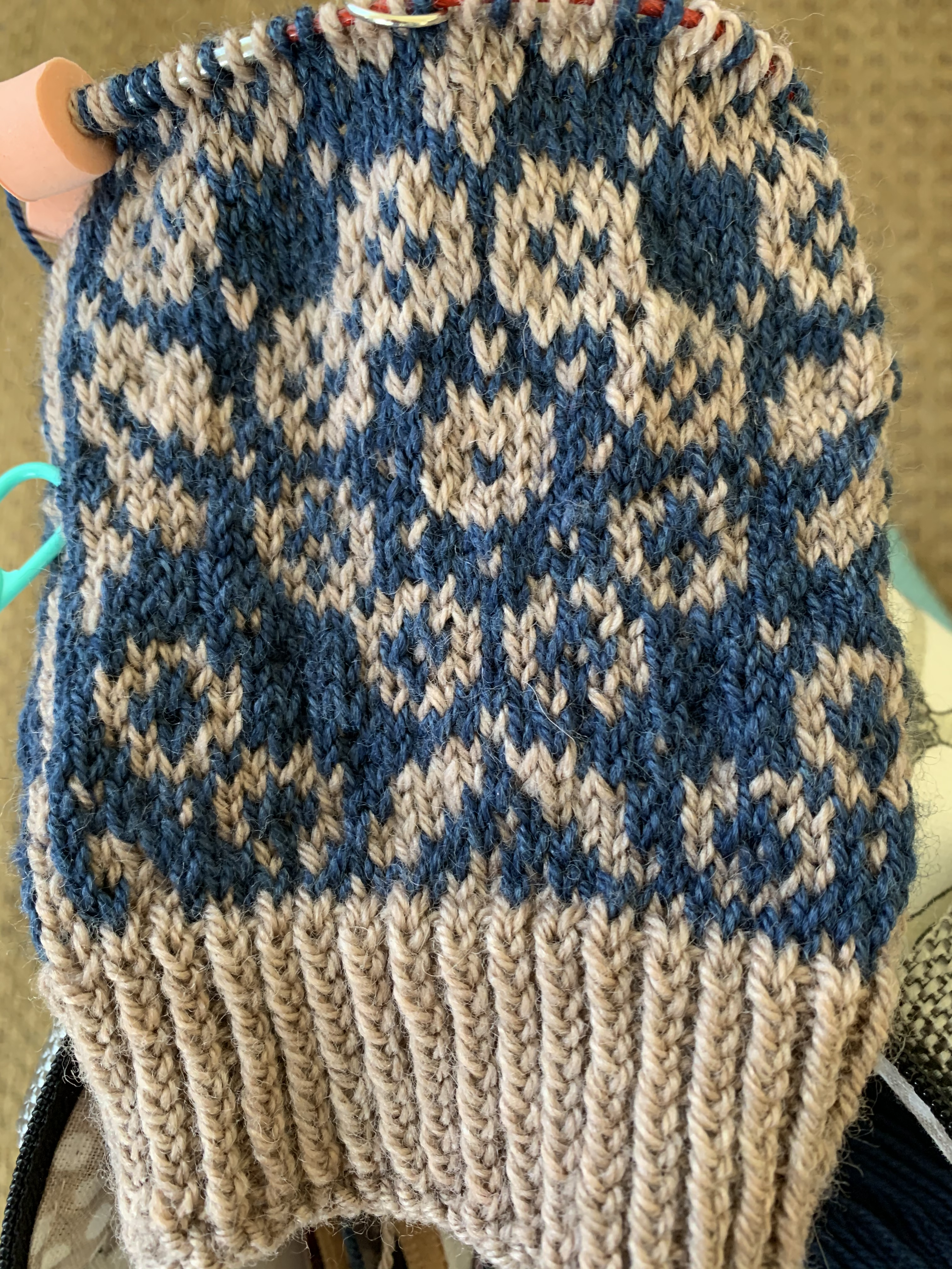 Colorwork flowers on the Wild Angelica socks knitting pattern showing color dominence.