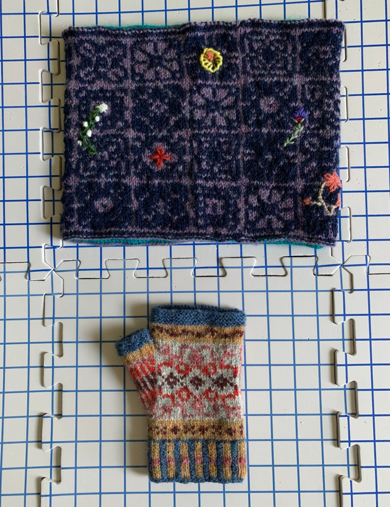 Fair isle wool knitting mitts and cowl drying on boards