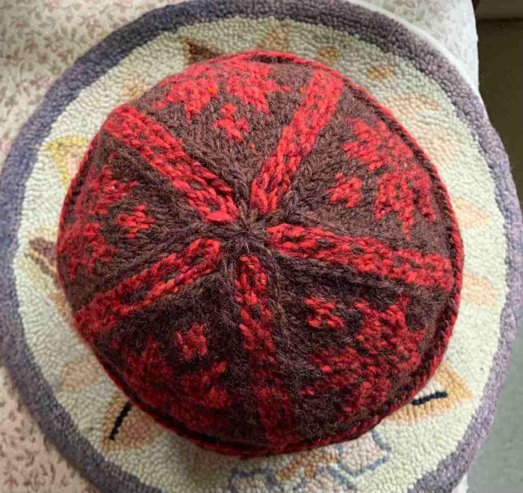 Triple Patterned Watchcap knit in brown and red wool crown of hat