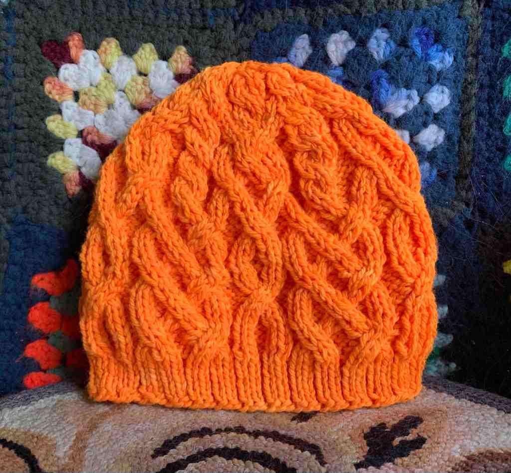 Cabled beanie in bright orange Habitat pattern