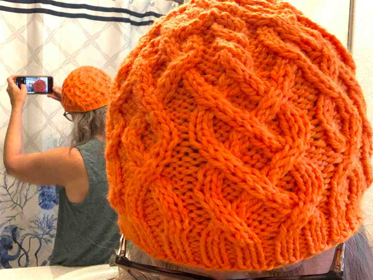 getting the shot newly knit cabled beanie