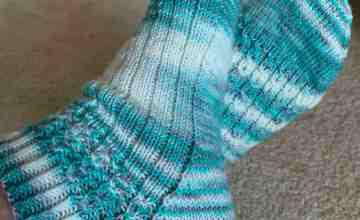 hand knit socks in aqua blue variegated yarn